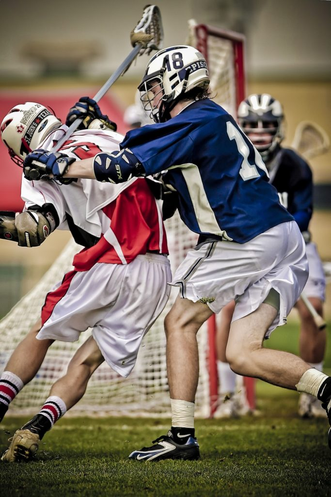 this picture of a lacrosse game in highschool