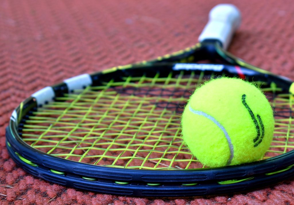 this picture shows a tennis racket and tennis ball